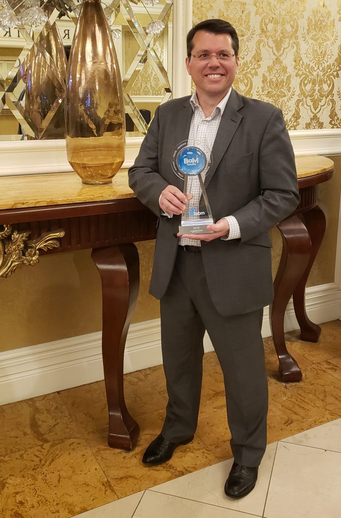 Stuart Newton with OptiQ award